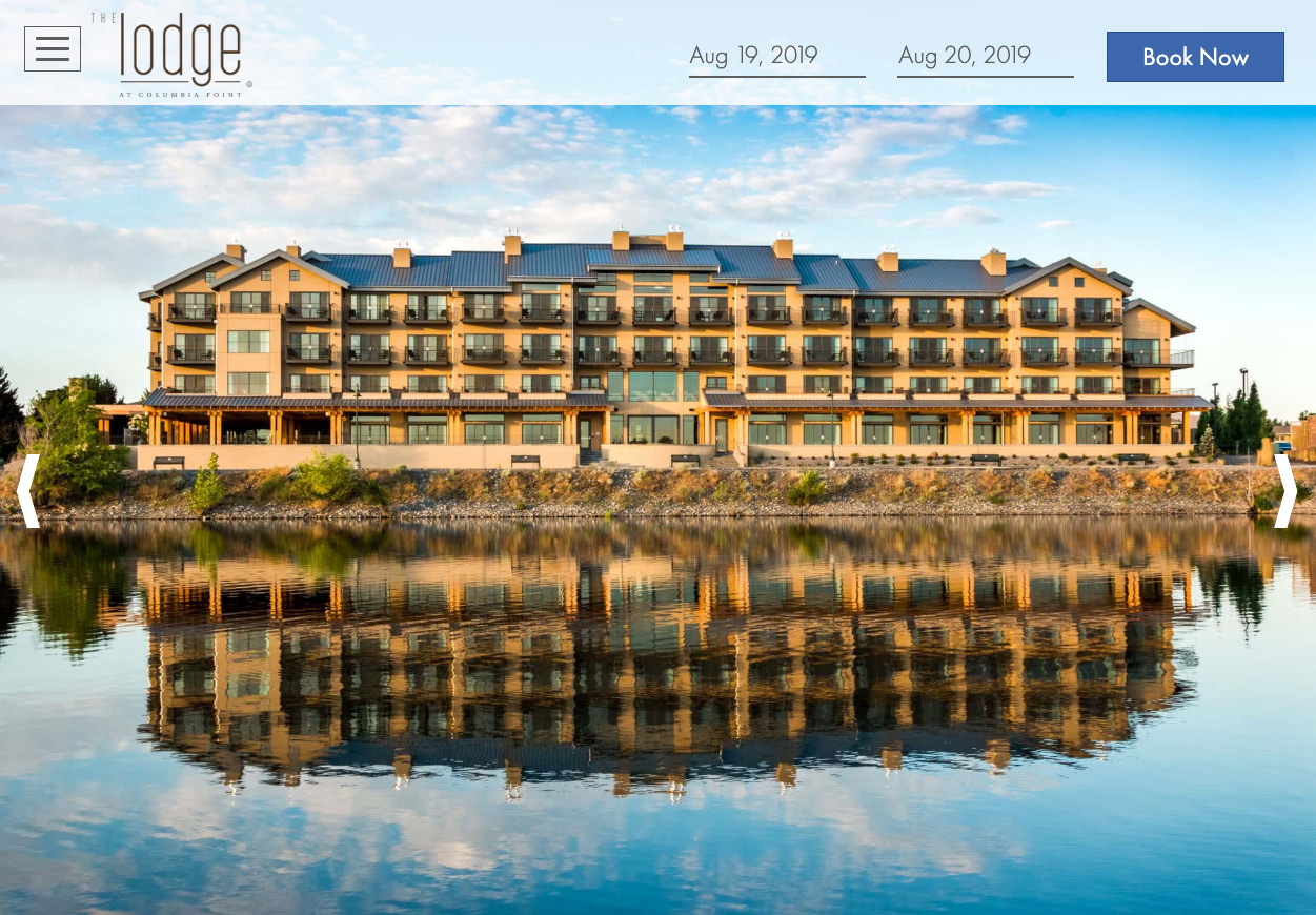 Lodge at Columbia Point river side reflection